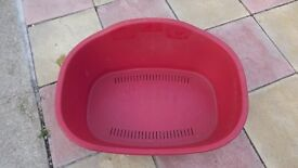 Two dog beds for sale one red and one grey plastic