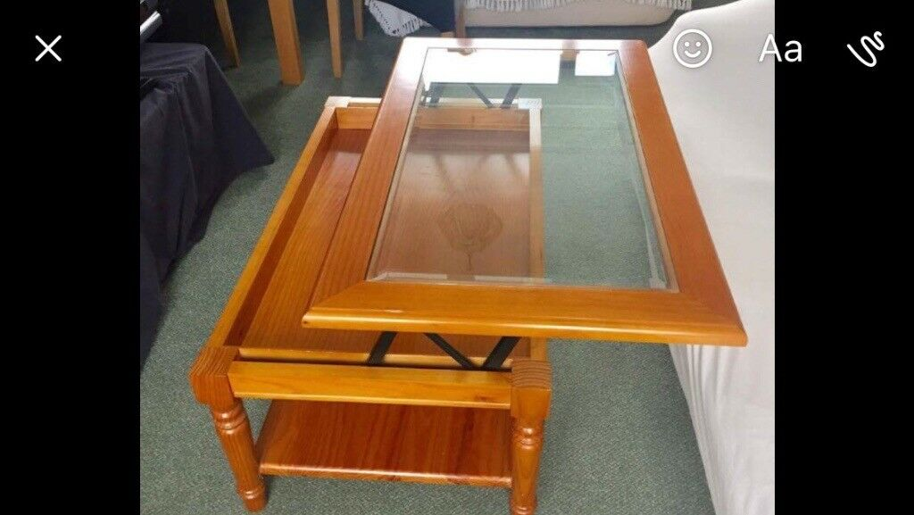 Coffee table which opens up to eat at. Can be decorated inside with lights or tinsel etc at Xmas