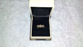 Stunning diamond trilogy ring for sale,unworn,purchased in 1965,valued £6100