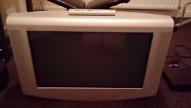 Sony 28in TV with remote and glass unit.