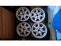 """Mazda 14 """"Daisy wheels and centre caps"""