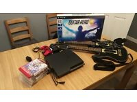 PlayStation 3 Slim (120GB) with 2 controllers, games and 2 guitars