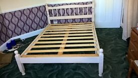 Beige wooden double bed frame