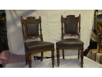 Set of 6 old solid wood framed dining chairs with upholstered back and seat.