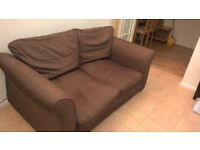 brown two seater fabric sofa