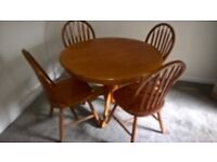 free table for kitchen or dining room including 4 chairs, solid wood on great condition