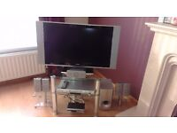 """32"""" TV, dvd player with surround sound, freeview box, all with glass stand"""