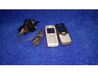 2 Nokia mobile phones (2) with charger