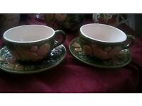 TWO WHATS-VINCENT CADEAUX DECORATED TEA CUP AND SAUCER