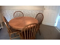 Oak circular, extendable, pedestal style dining table and 4 chairs.
