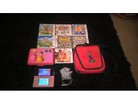 pink nintendo 3ds and games