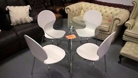 glass dining table with white or black chairs