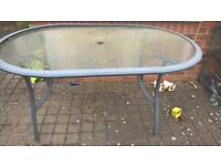 Glass topped garden table - heavy weight