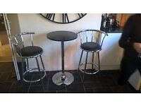Breakfast table with two stools