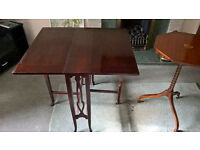 Wooden table in dark wood with foldable leg support Edwardian