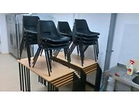 10 x office tables and 10 x plastic black office chairs