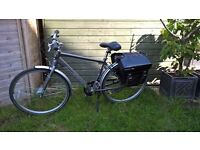 "GIANT TWIST LITE Electric bicycle with panniers. Medium Frame. 26"" wheels. 26V 9Ah battery."