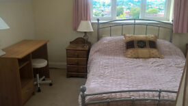 Monday-Friday let only - sunny bedroom with private ensuite,close to Guildford centre.