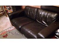Sofa black leather. Spacious 2 seater. Comfy.