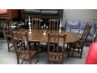 stunning ercol dining table and 6 high back colonial chairs