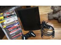PlayStation PS3 Super Slim 500GB with controller and all cables + 20 games.