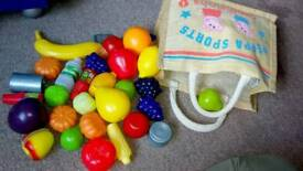 Plastic fruit and veg with shopping bag