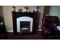 wooden fire surround with fire
