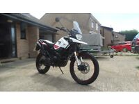 WK 400 Trail. Very low mileage. As New condition. Custom seat with gel Inserts