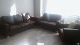 chocolate brown leather three seater, two seater and armchair