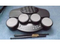 electronic drum machine, with loads of different effects, and drum sticks