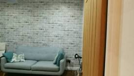 Wall papering and painting,tiling , feature walling,including rubbish removal