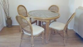 Cane conservatory table and chairs