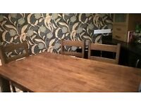 Heavy, sturdy, solid wood dining table and six chairs in very good condition