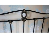 Double bed headboard with brass finials. Excellent condition