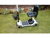 ultralite 4 mph mobility scooter in lovely condition and takes apart easy & quick for loading