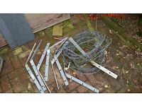 Used barbed wire & brackets.