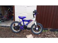 Raleigh RMX 14 inch boys bicycle. Blue and white