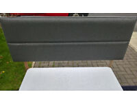 A New Myers King Size Grey Upholstered Headboard.