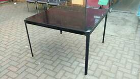 Black glass and metal dining table