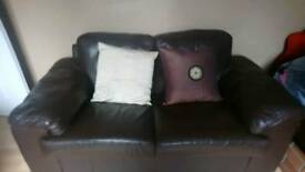 2 Sofas. One small and. One large.