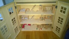Wooden Dolls House with lots of accessories, good condition