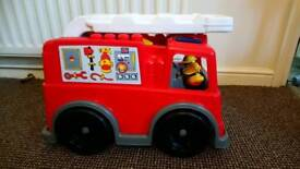 Mega blocks fire truck with blocks and 2 figures