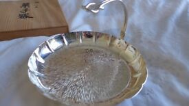 A Japanese, silver-finished serving dish, plus six matching individual plates and serving forks.