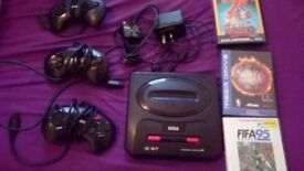 Sega Megadrive 2 with 3 controllers and 3 games