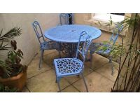 Metal patio table with 4 chairs
