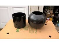 2 black vases one glass