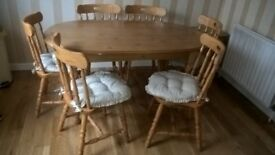 Pine kitchen table, six chairs and seat cushions