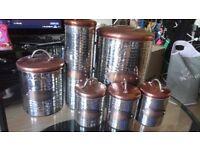 Six piece hammered effect steel kitchen storage tins with copper lids