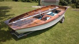 Mirror sailing dinghy with launching trolley