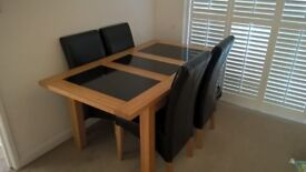 Dfs solid wood dinning table good quality will include 6 free chairs, quick sale, open to offers